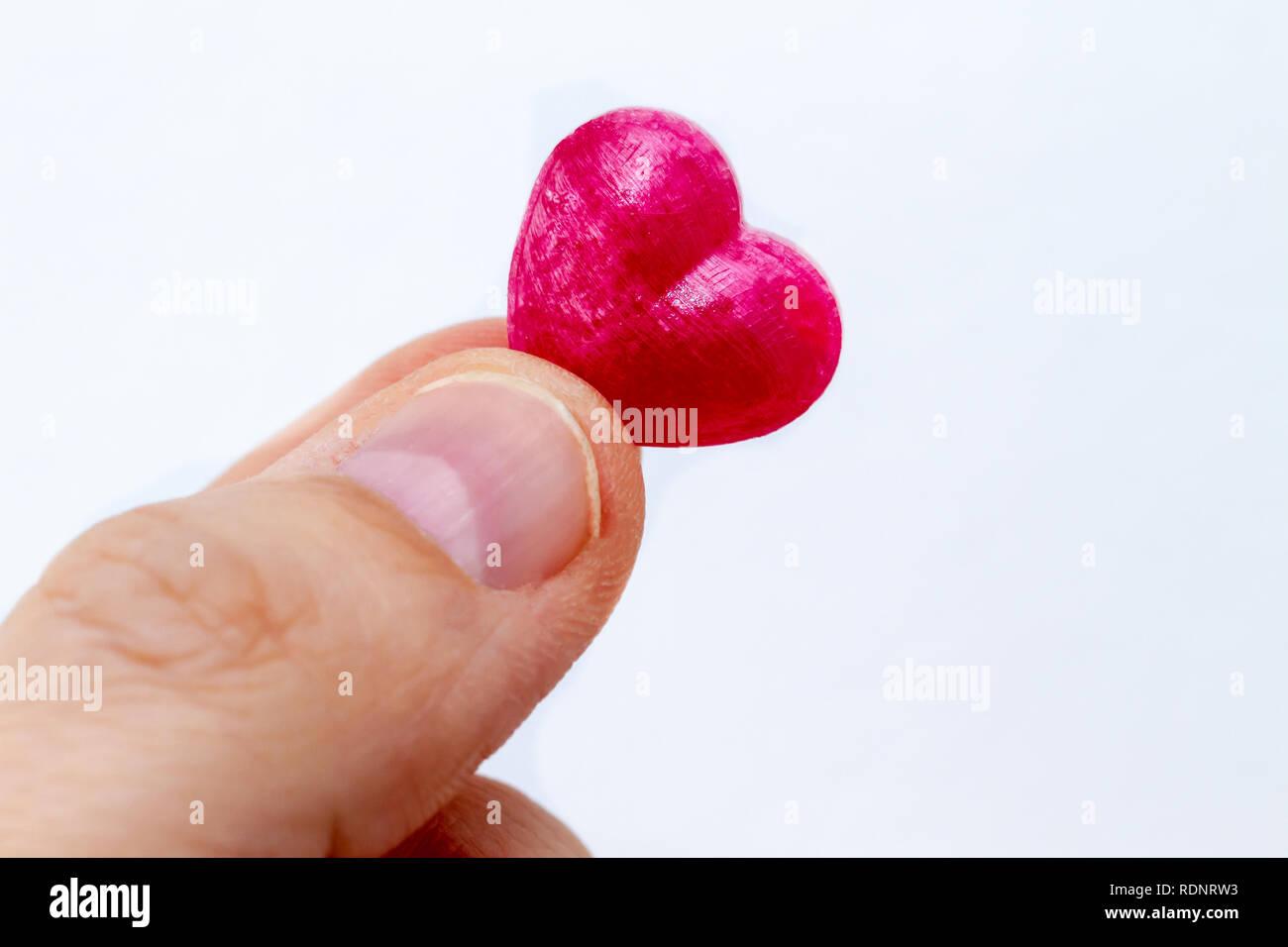 Poco candy cuore del dito Immagini Stock