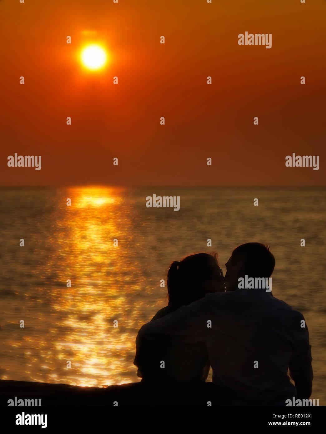 Saluti e Baci al tramonto. Umore romantico. Immagini Stock