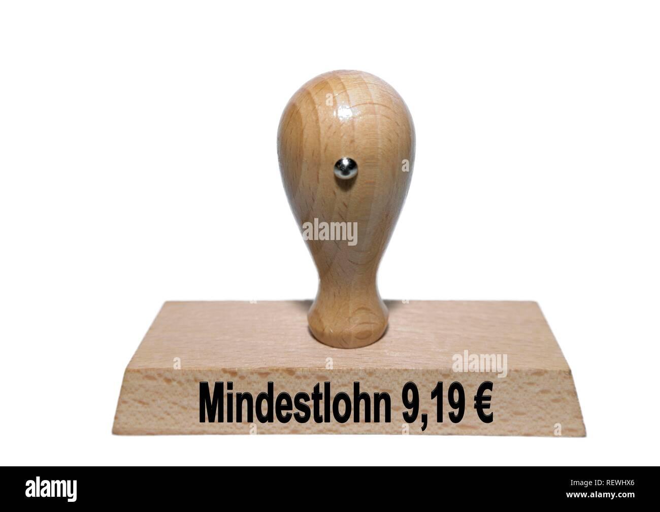 Immagine di simbolo, timbro con iscrizione salario minimo 9,19€, intaglio, Germania Foto Stock
