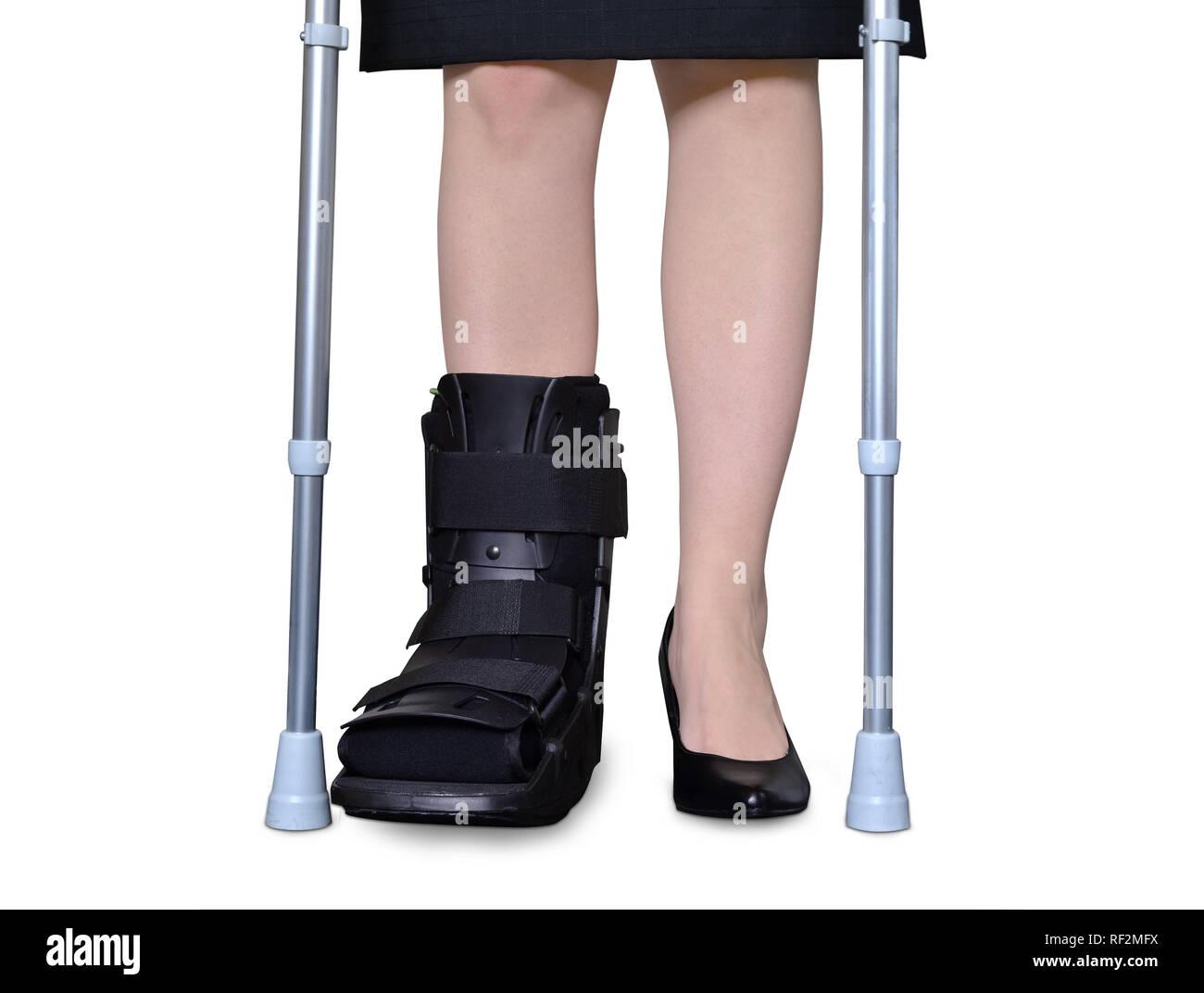 Tutore cervice groppa lardoni fissatore frattura rotto sneaker Foto Stock