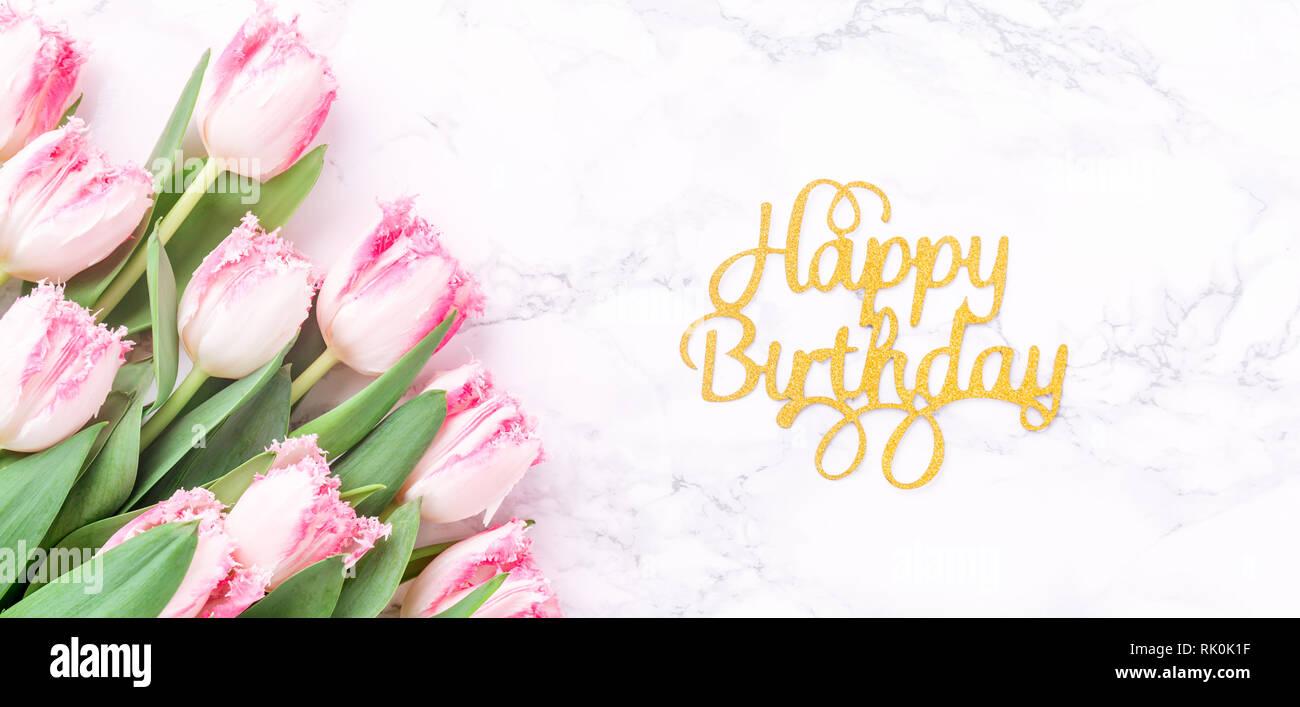 Tulipani Rosa E Oro Buon Compleanno Lettere Su Marmo Bianco Dello