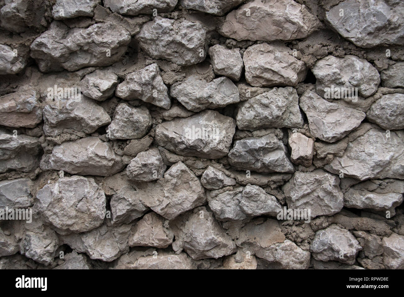 Muro Fatto In Pietra il muro fatto di pietre grigie e cemento foto & immagine