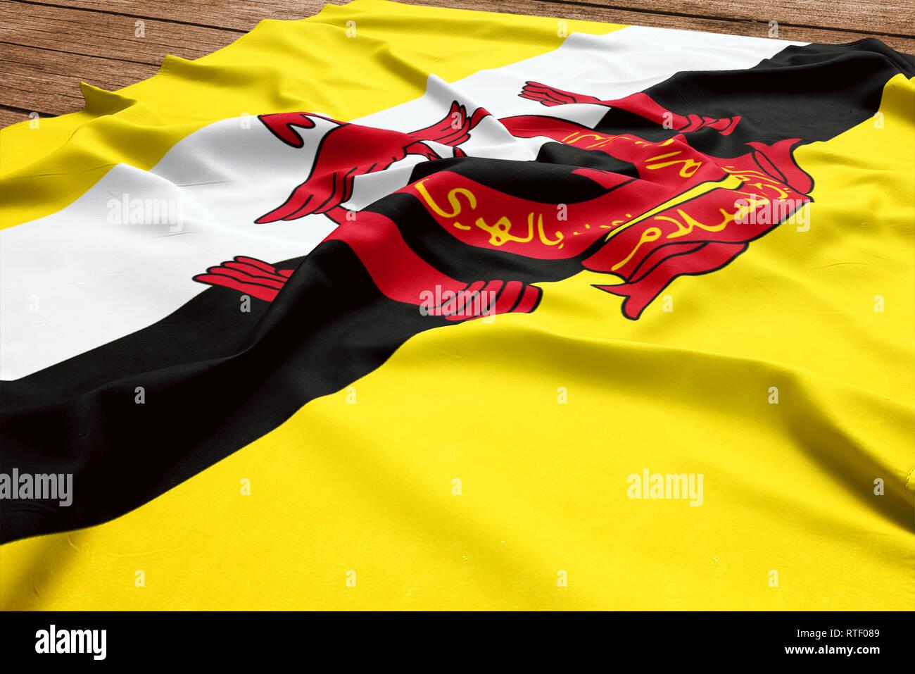 Bandiera del Brunei su una scrivania in legno sfondo. Seta flag Bruneian vista dall'alto. Immagini Stock