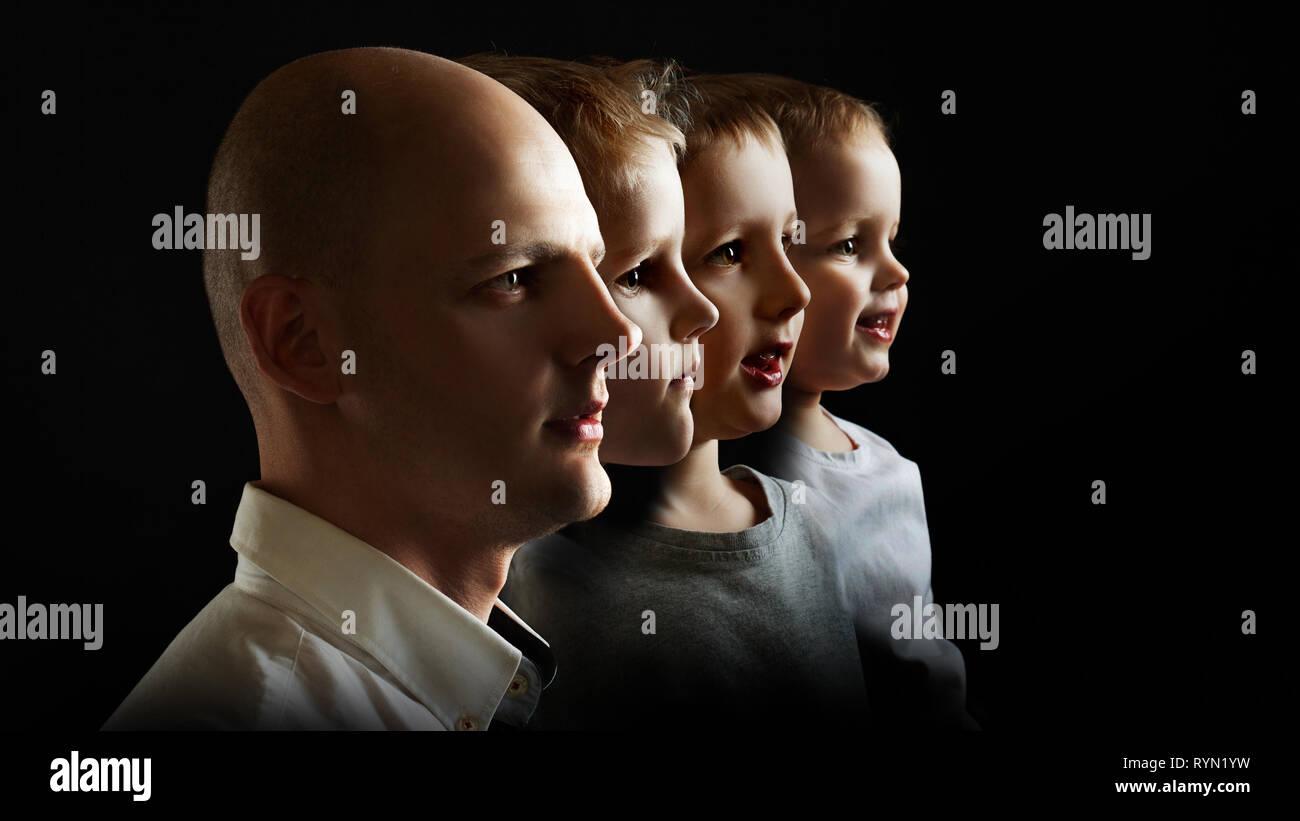 Padre e figli, il concetto di genetica e di ereditarietà. Giovane uomo e figli di età diversa, ritratto di profilo su sfondo nero Immagini Stock