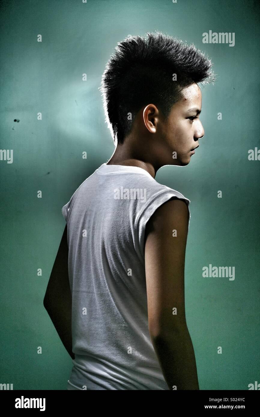 Ritratto di un maschio adolescente asiatica Immagini Stock