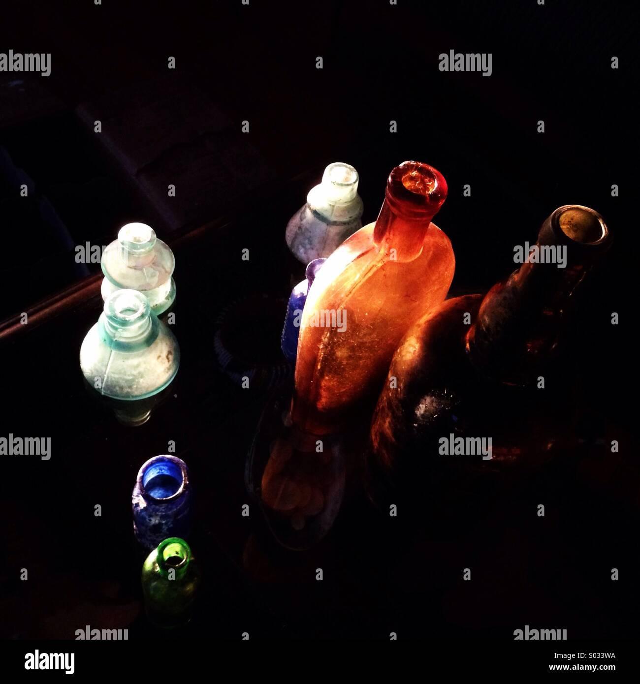 Bottiglie di antiquariato. Immagini Stock