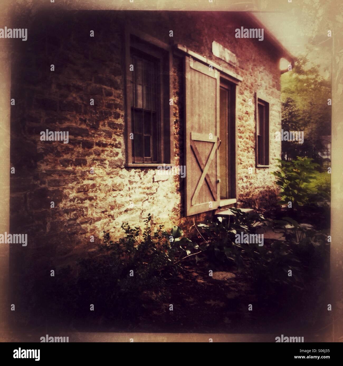 Un cottage in pietra. Immagini Stock