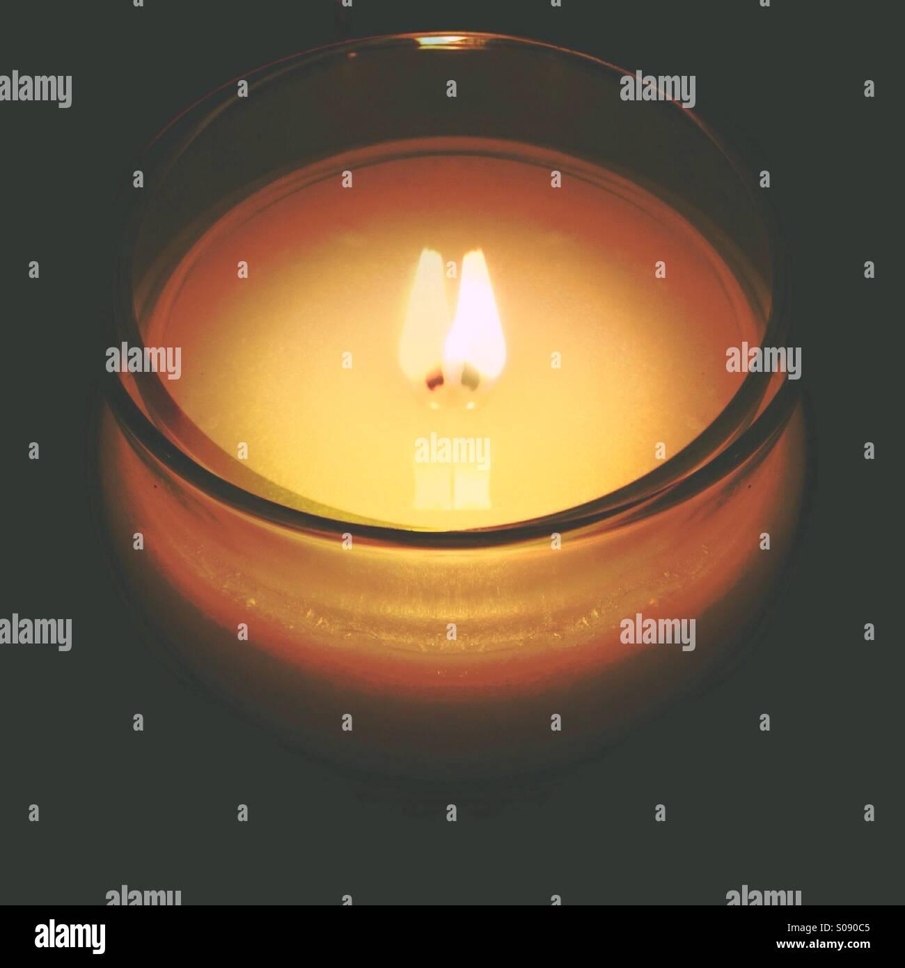 Candela con doppia fiamma (effetto) Immagini Stock
