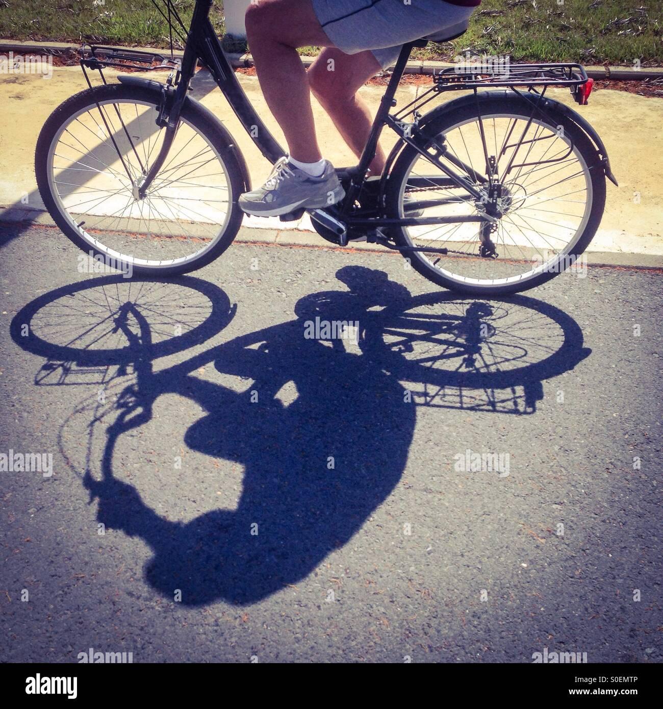 Ciclista e ombra Immagini Stock