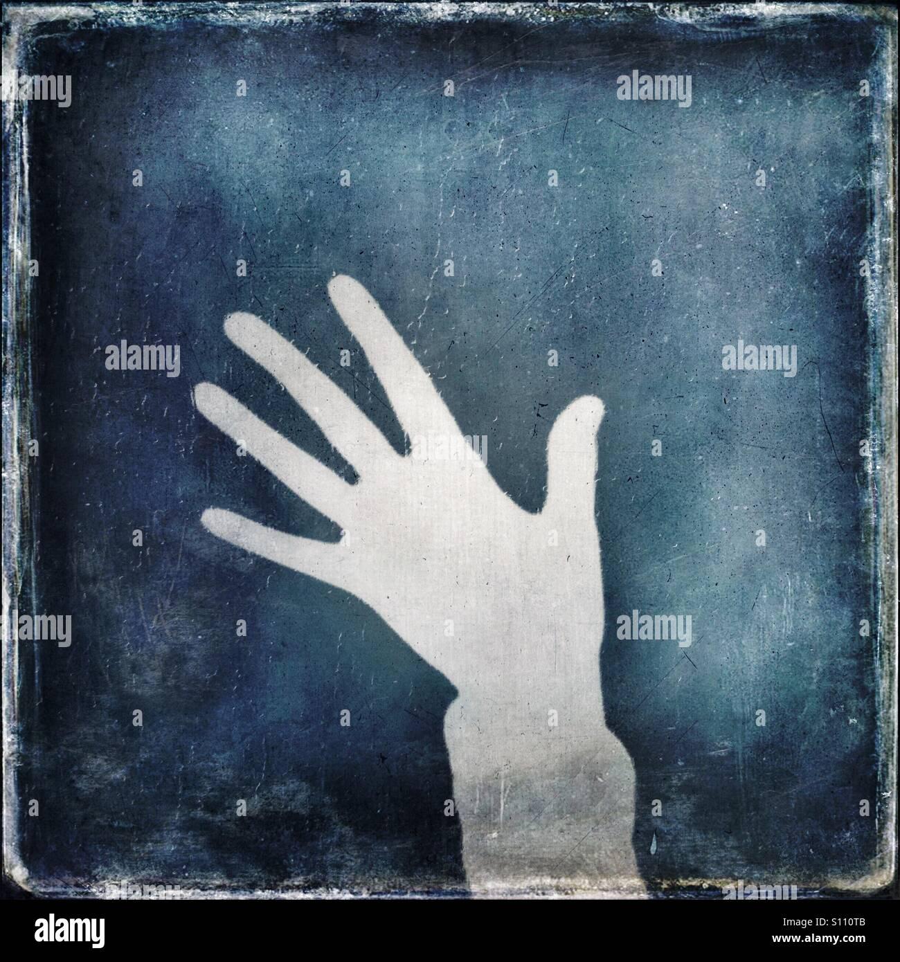 Ombra di una mano che mostra cinque dita Immagini Stock
