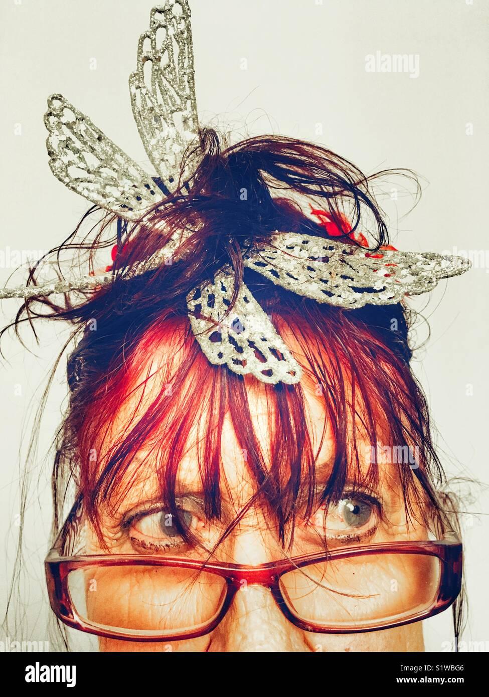 La donna a farfalla Immagini Stock