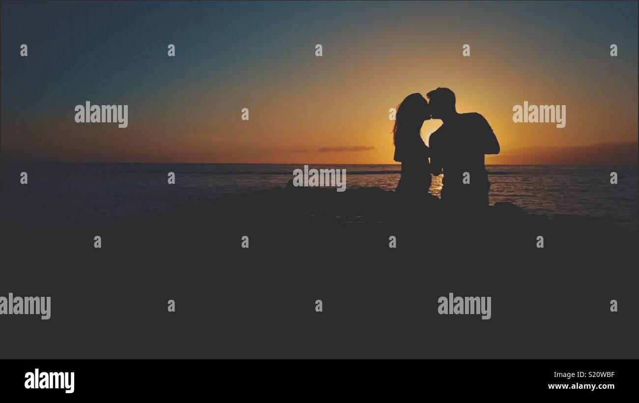 Bacio al tramonto Foto Stock