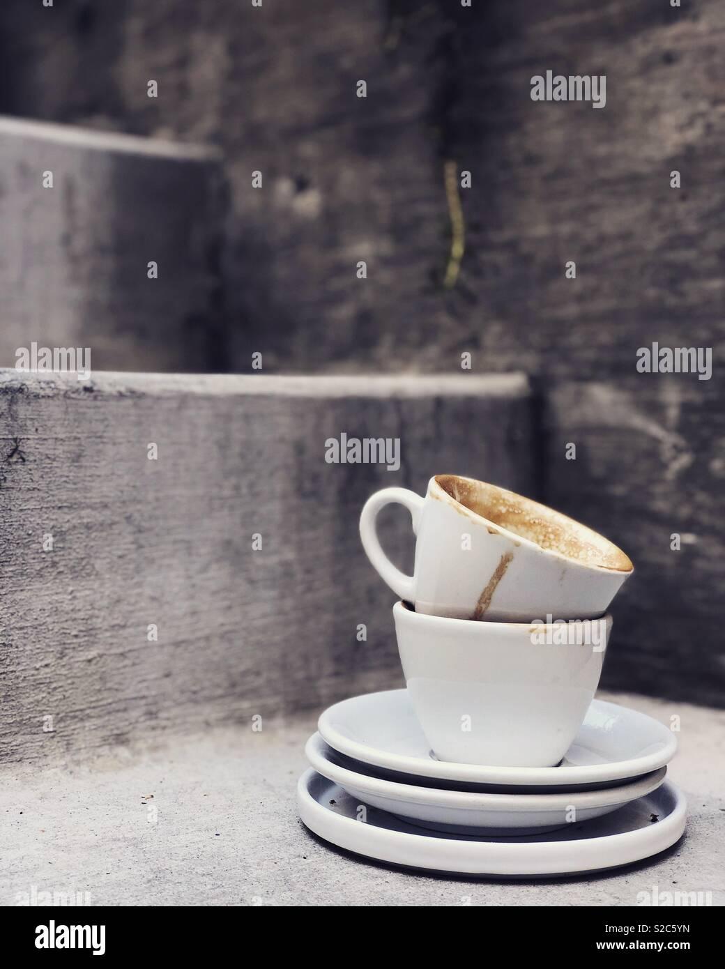 Svuotare le tazze di caffè Immagini Stock