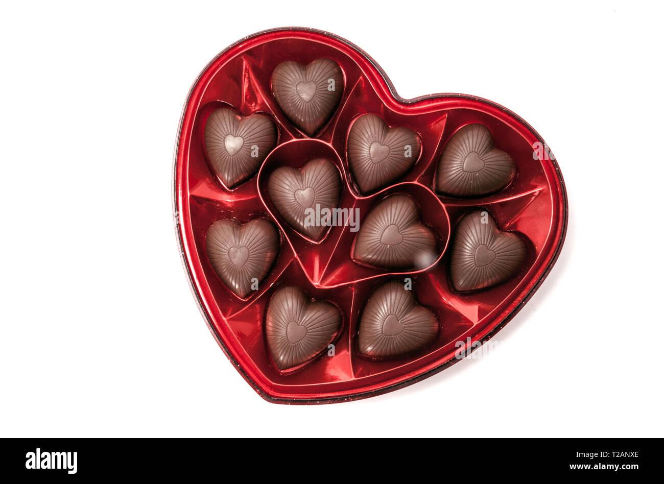 Cuore scatola sagomata di San Valentino caramella di cioccolato isolato su bianco Immagini Stock