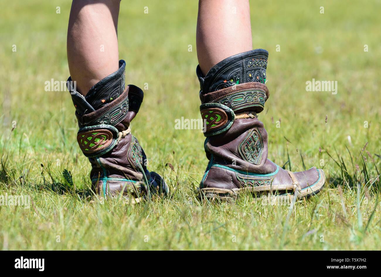 Naadam Festival in Khatgal, Mongolia. Stivali di un lottatore Immagini Stock