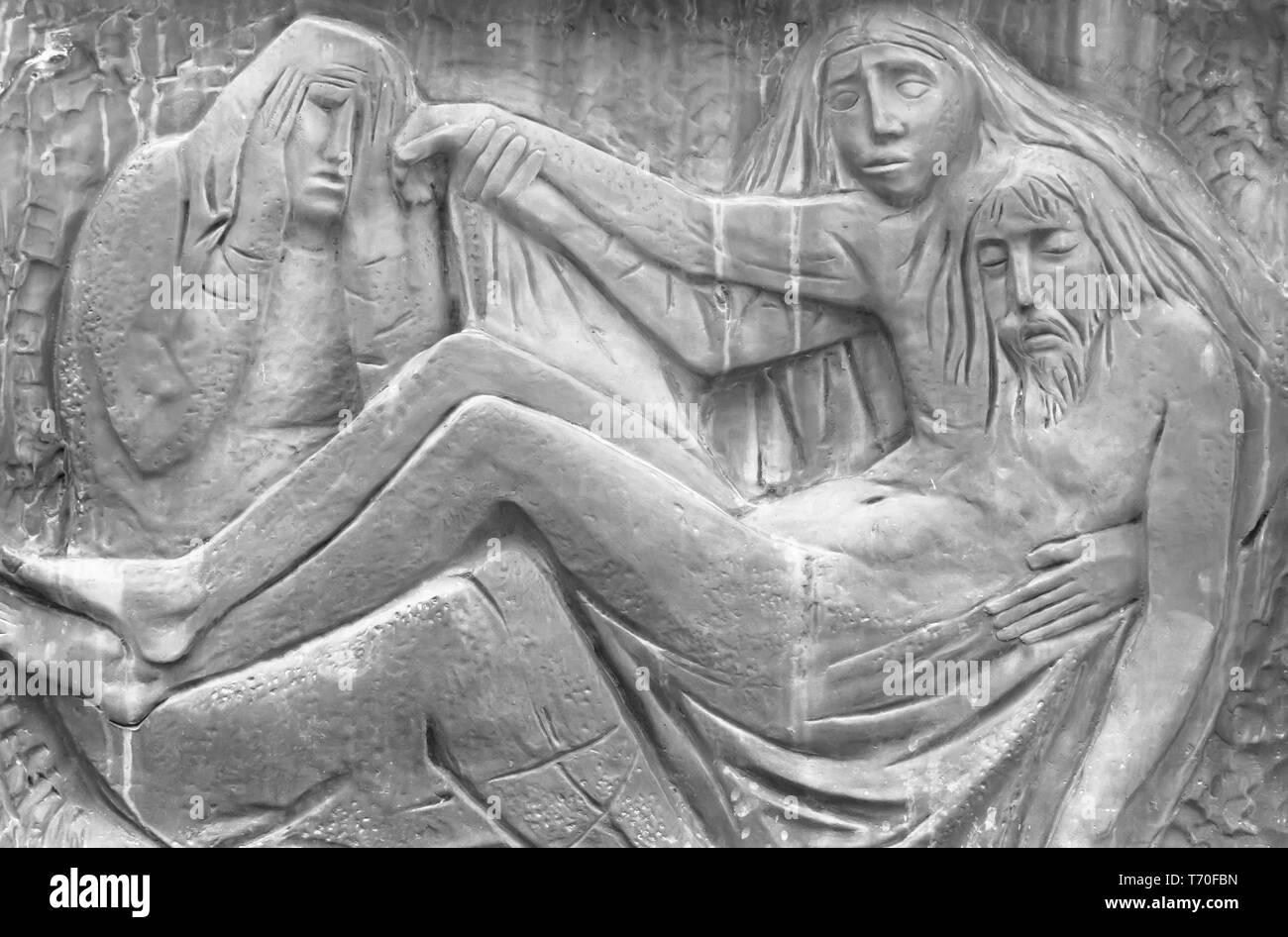 Bassorilievo raffigurante la Pietà di Michelangelo Immagini Stock