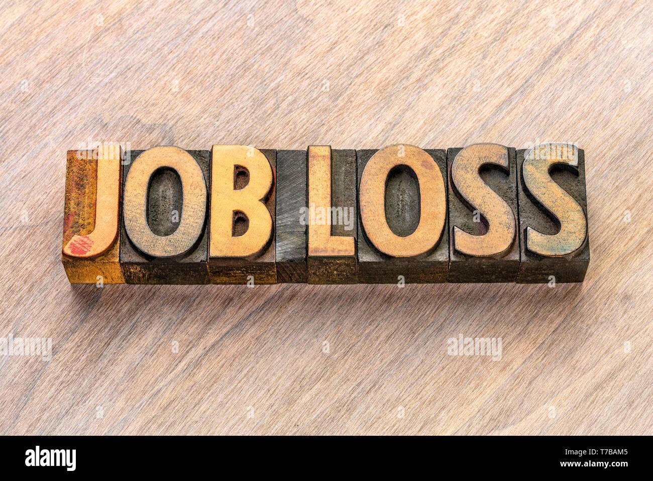 La perdita del posto di lavoro astratto di parola in rilievografia vintage tipo legno Immagini Stock