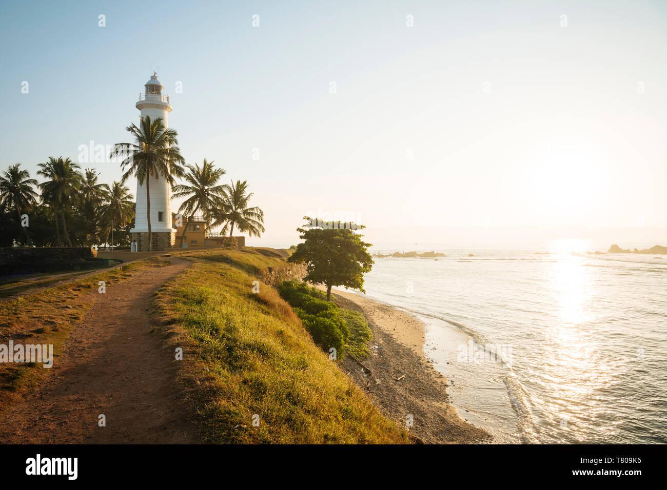 Galle Faro all'alba, Galle, Città Vecchia, sito Patrimonio Mondiale dell'UNESCO, South Coast, Sri Lanka, Asia Foto Stock