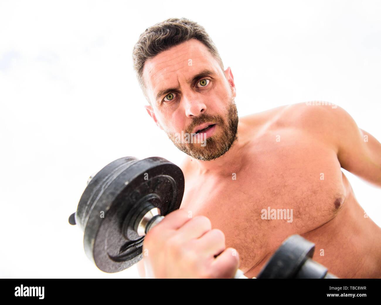 Stile di vita sportiva. Il successo è scelta. La vittoria è abitudine. Il manubrio palestra. Uomo muscolare che esercitano con il manubrio. Sportivo con forte torso. Attrezzature sportive. Fitness e bodybuilding sport. Immagini Stock