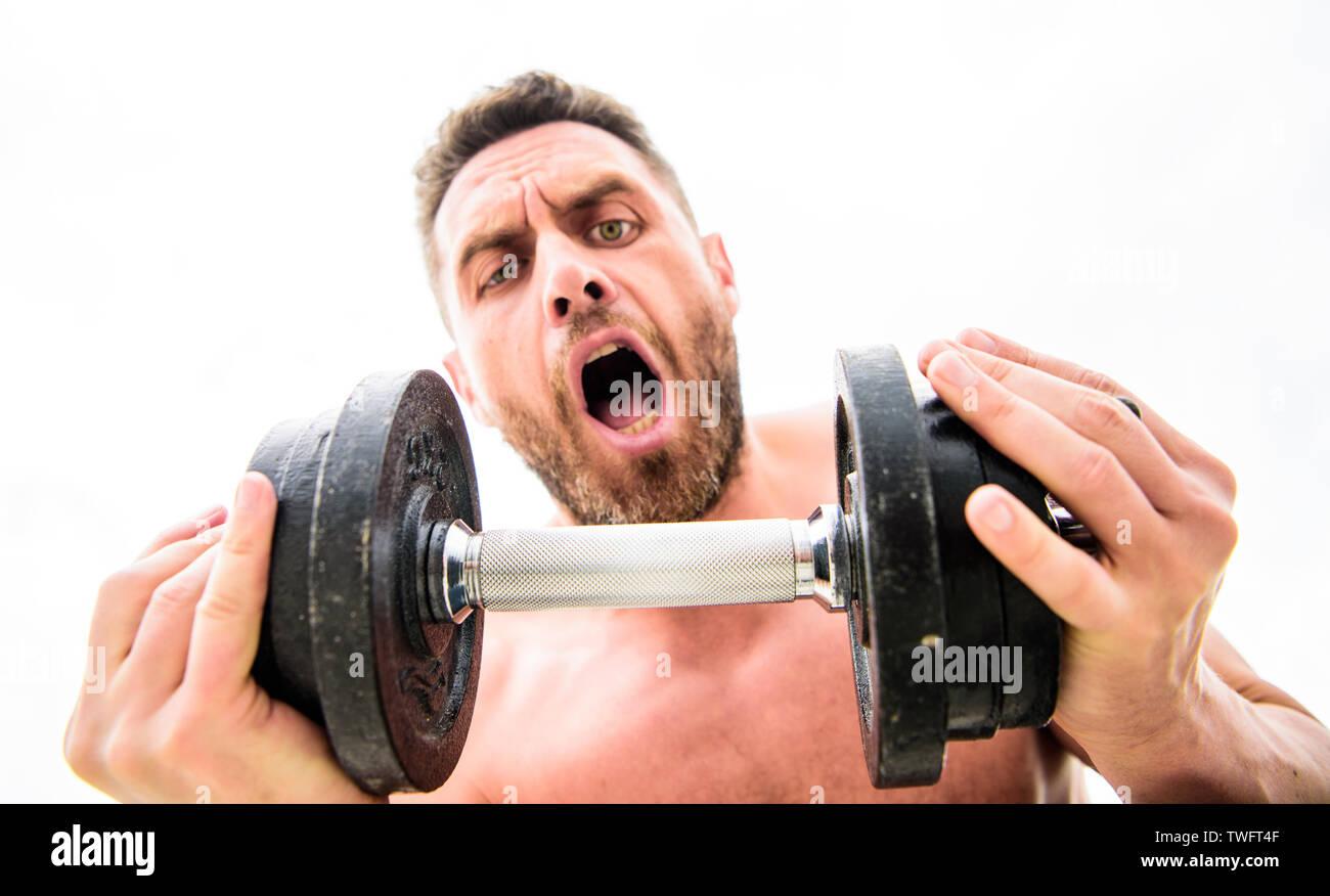 Il successo è scelta. La vittoria è abitudine. Il manubrio palestra. Uomo muscolare che esercitano con il manubrio. Sportivo con forte torso. Attrezzature sportive. Fitness e bodybuilding sport. Stile di vita sportiva. Immagini Stock