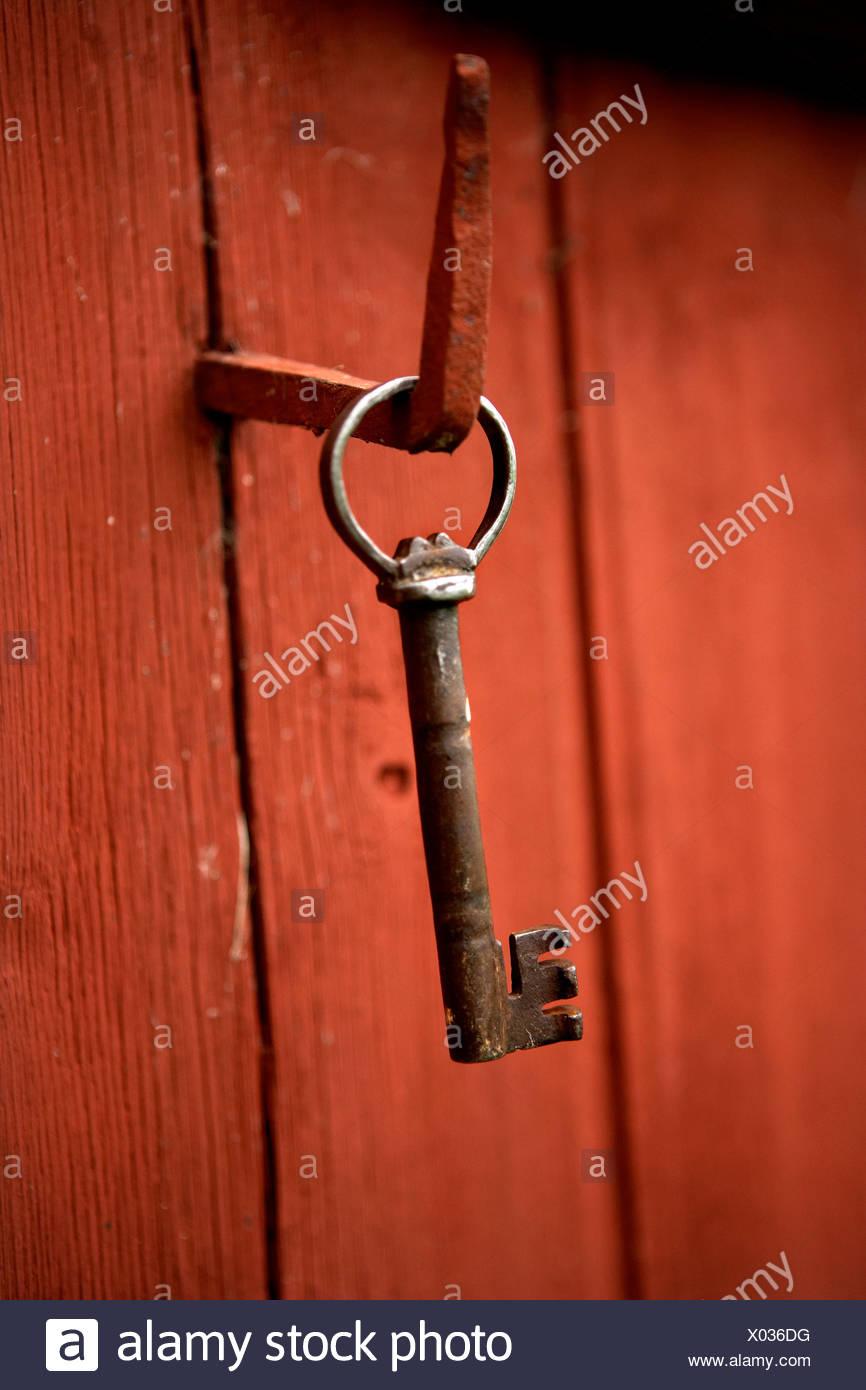 Close-up di chiave appesa al gancio Immagini Stock