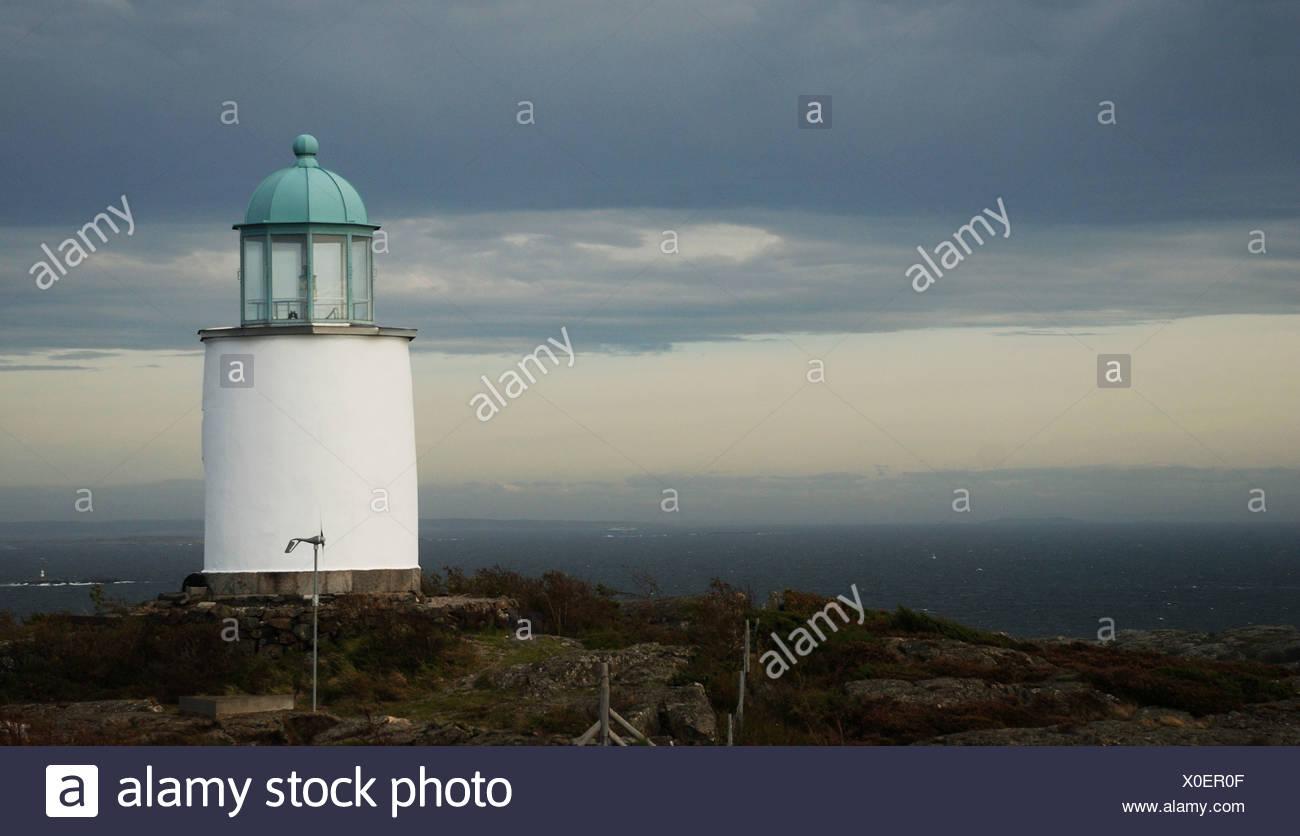 Faro in nuvoloso meteo Immagini Stock