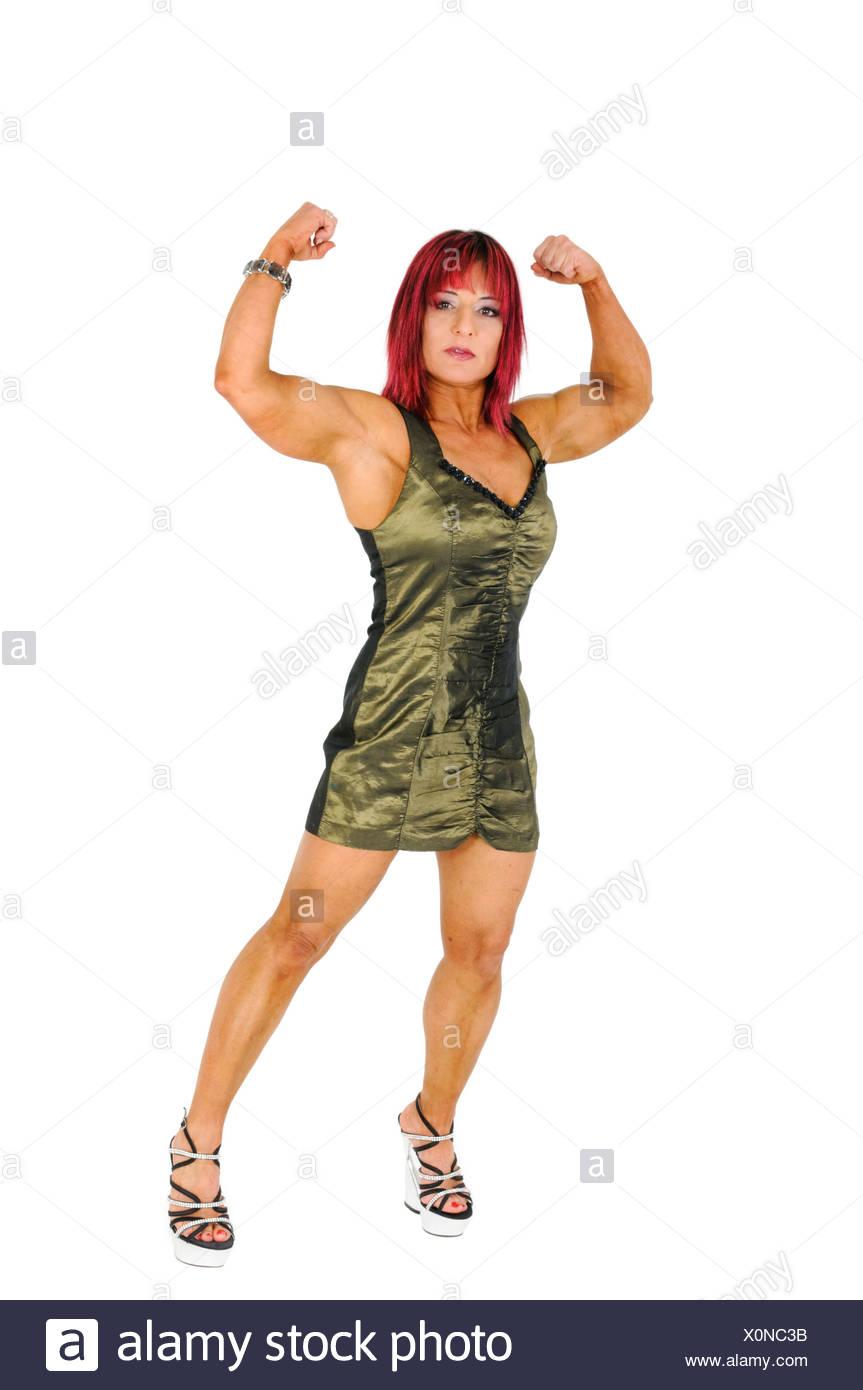 pretty nice f43d5 2816a Bodybuilder femminile in abito da sera, si flette i suoi ...