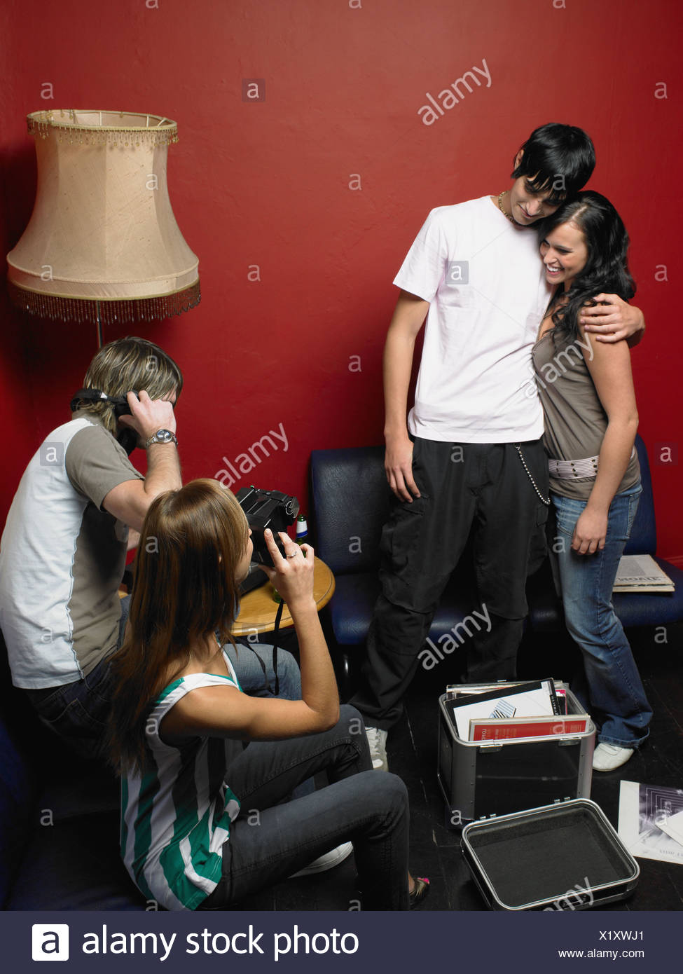 Quattro amici ad una festa Immagini Stock
