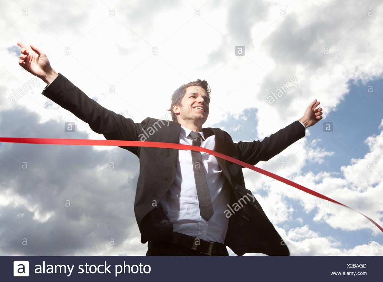 Imprenditore Attraversamento linea di finitura Immagini Stock