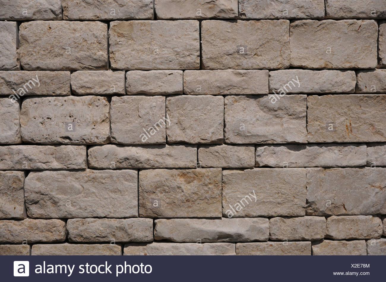 Muro fatto di pietre naturali Immagini Stock