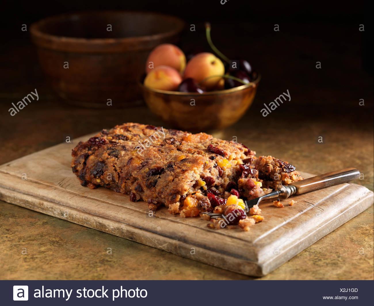 Festa di Natale ingredienti di maiale e marasca ripieno con ciliegie e pesche Immagini Stock