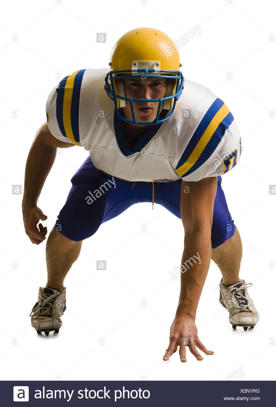Maschio giovane giocatore di football americano. Immagini Stock