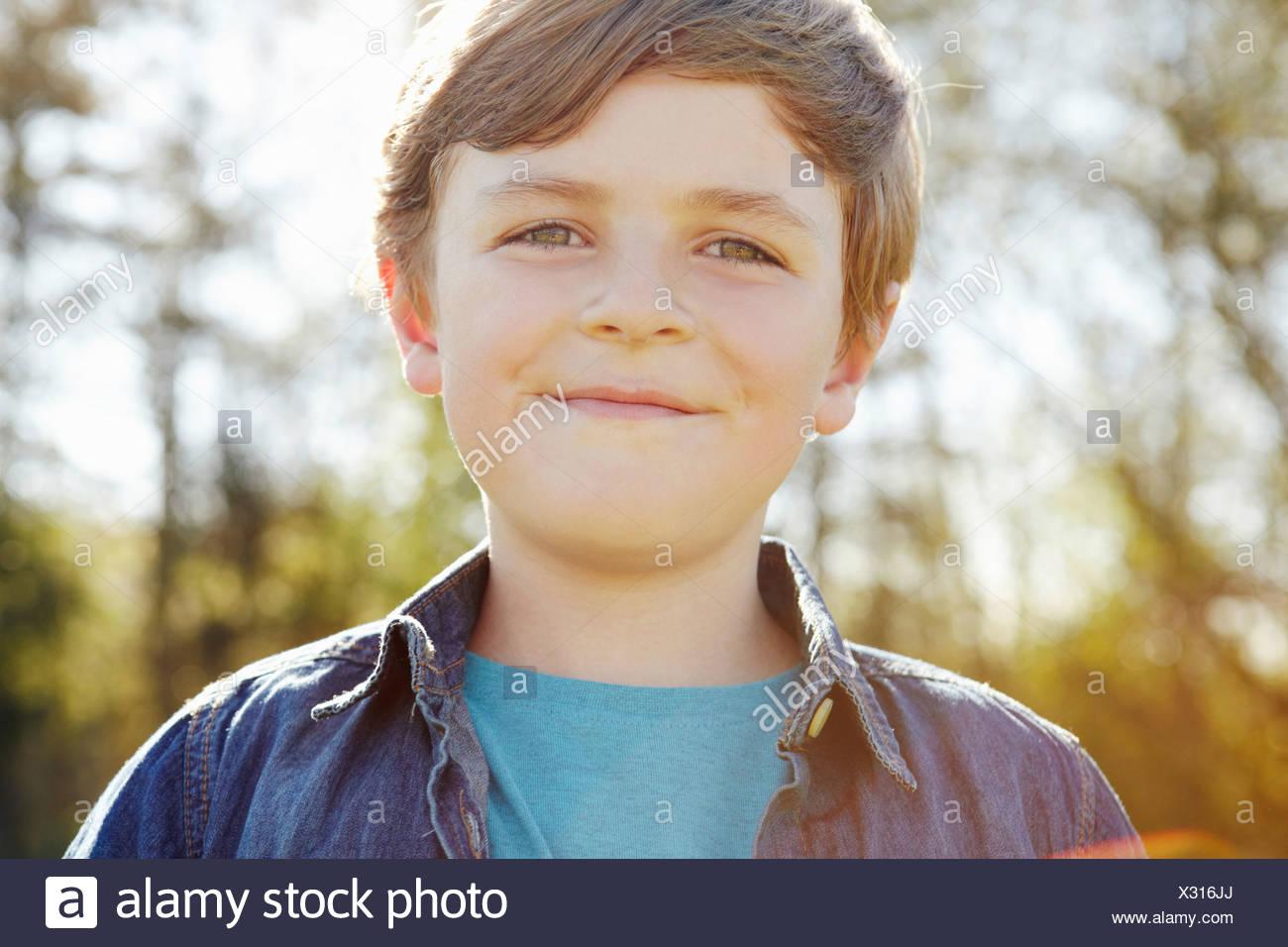 Ragazzo con cheeky grin Immagini Stock