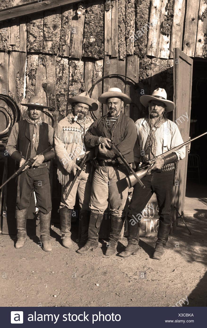 I cowboys con pistole Immagini Stock