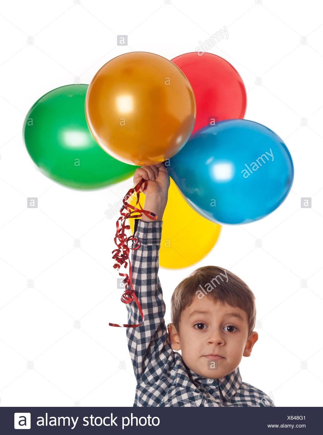 Ragazzo con palloncini Foto Stock