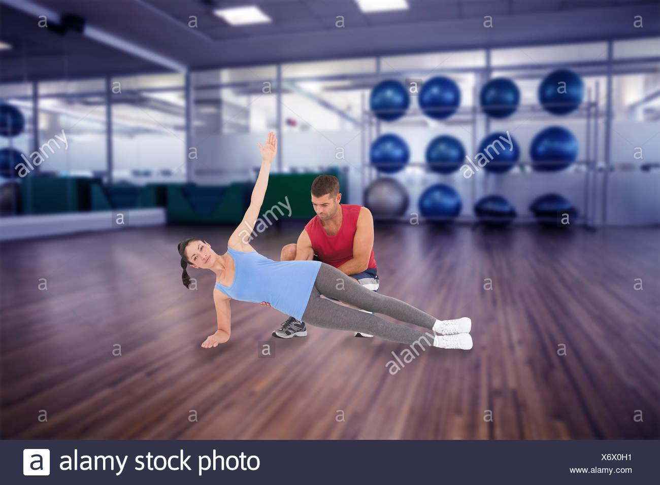 Immagine composita di personal trainer con il client Foto Stock