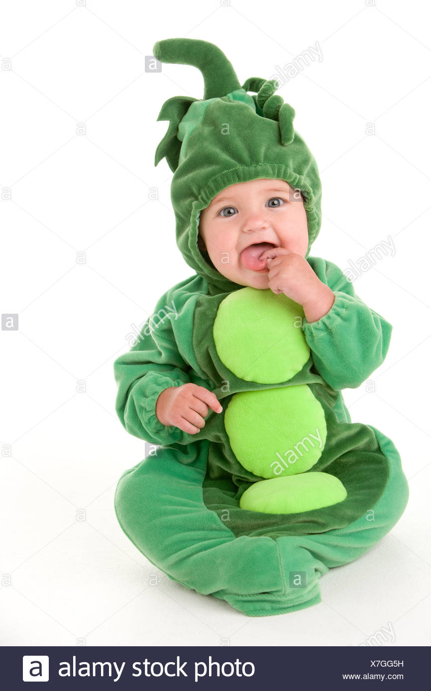 Bambino in piselli in costume pod Immagini Stock