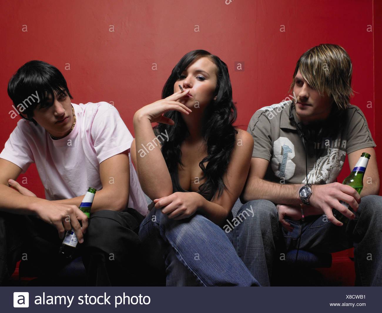 Tre amici ad una festa Immagini Stock