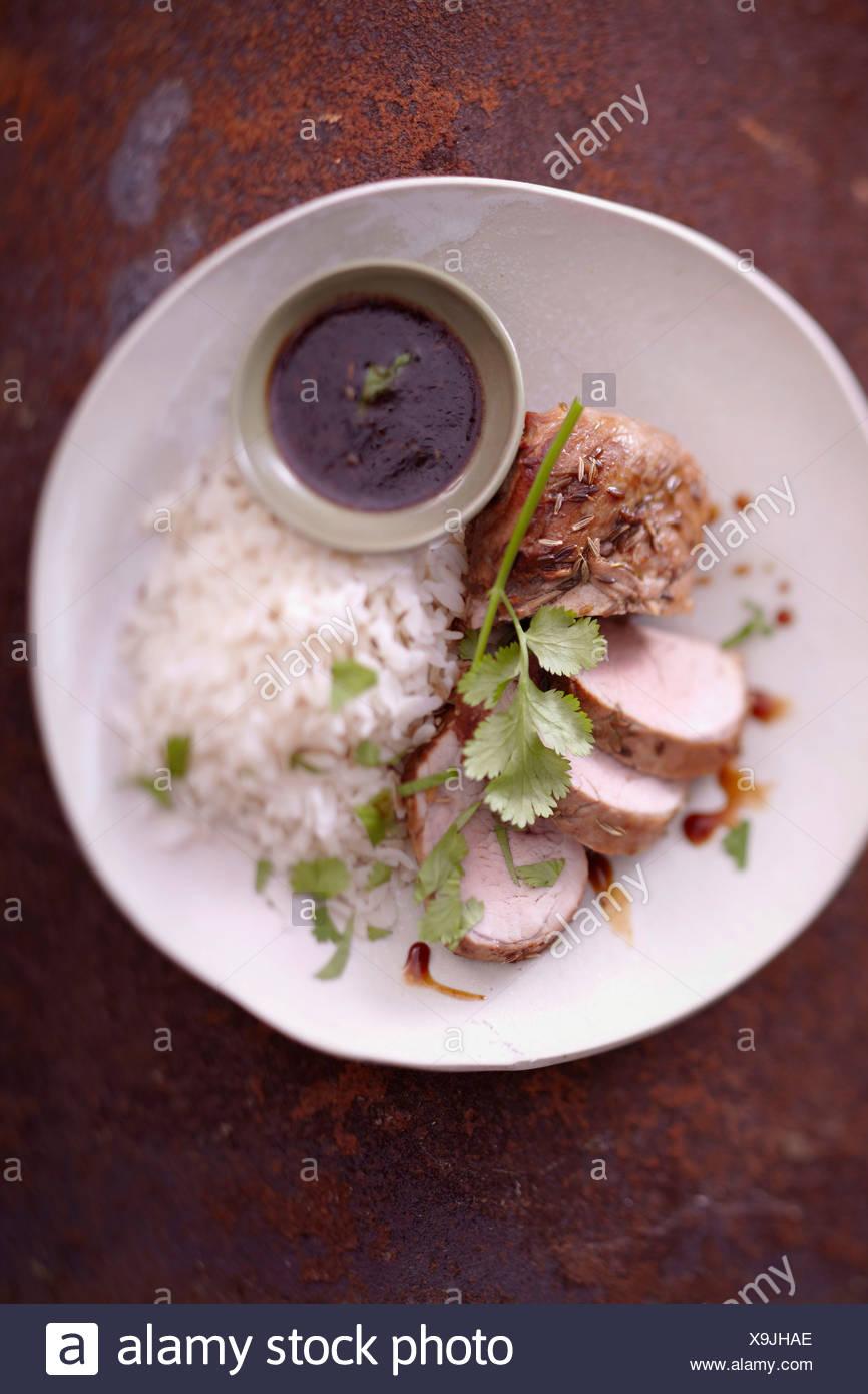 La carne di maiale filet mignon marinato nel miele e semi di finocchio,riso bianco Immagini Stock