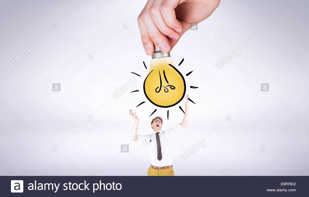 Immagine composita della mano che tiene la lampadina luce doodle Immagini Stock