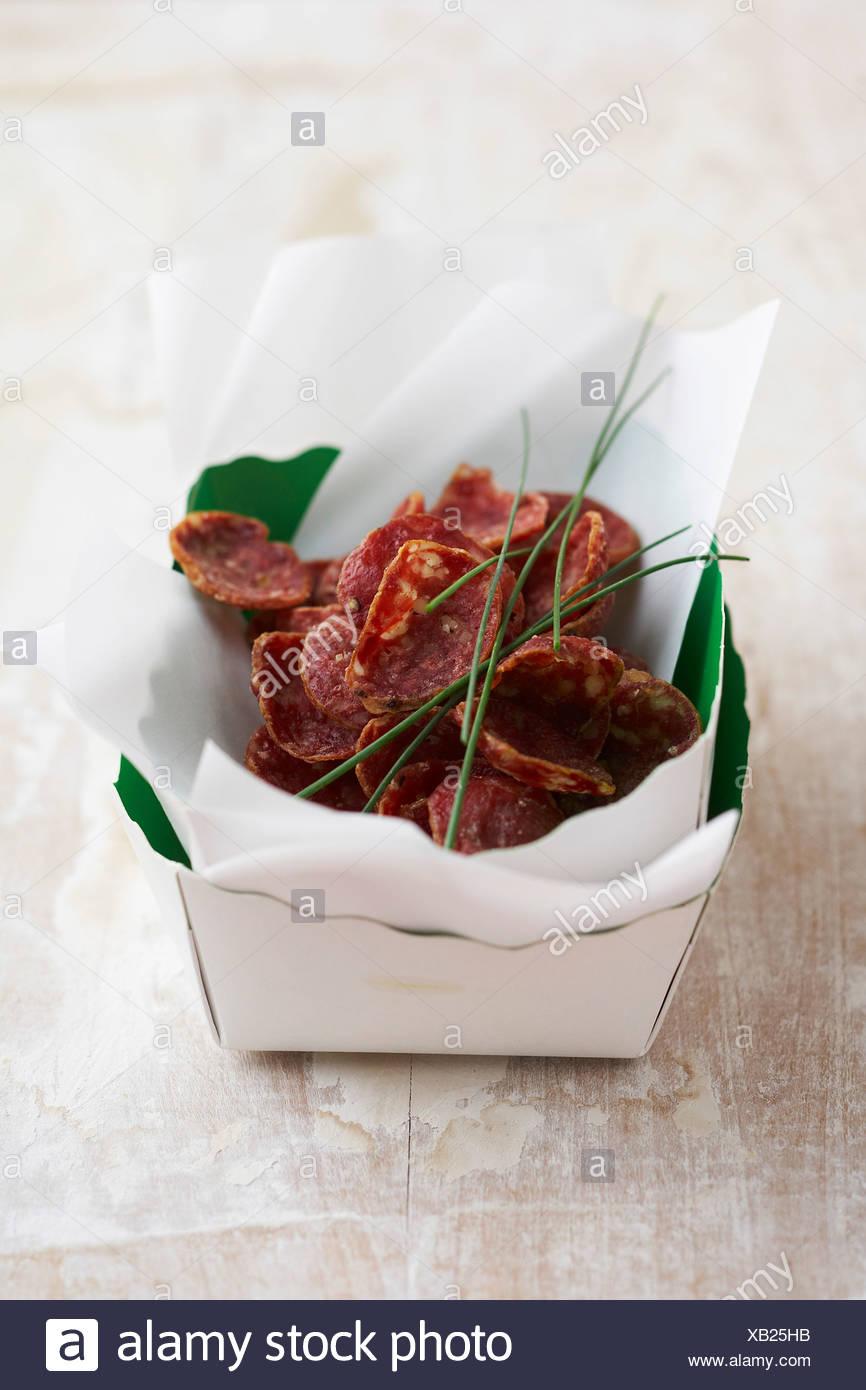 Salsiccia secca le patatine Immagini Stock