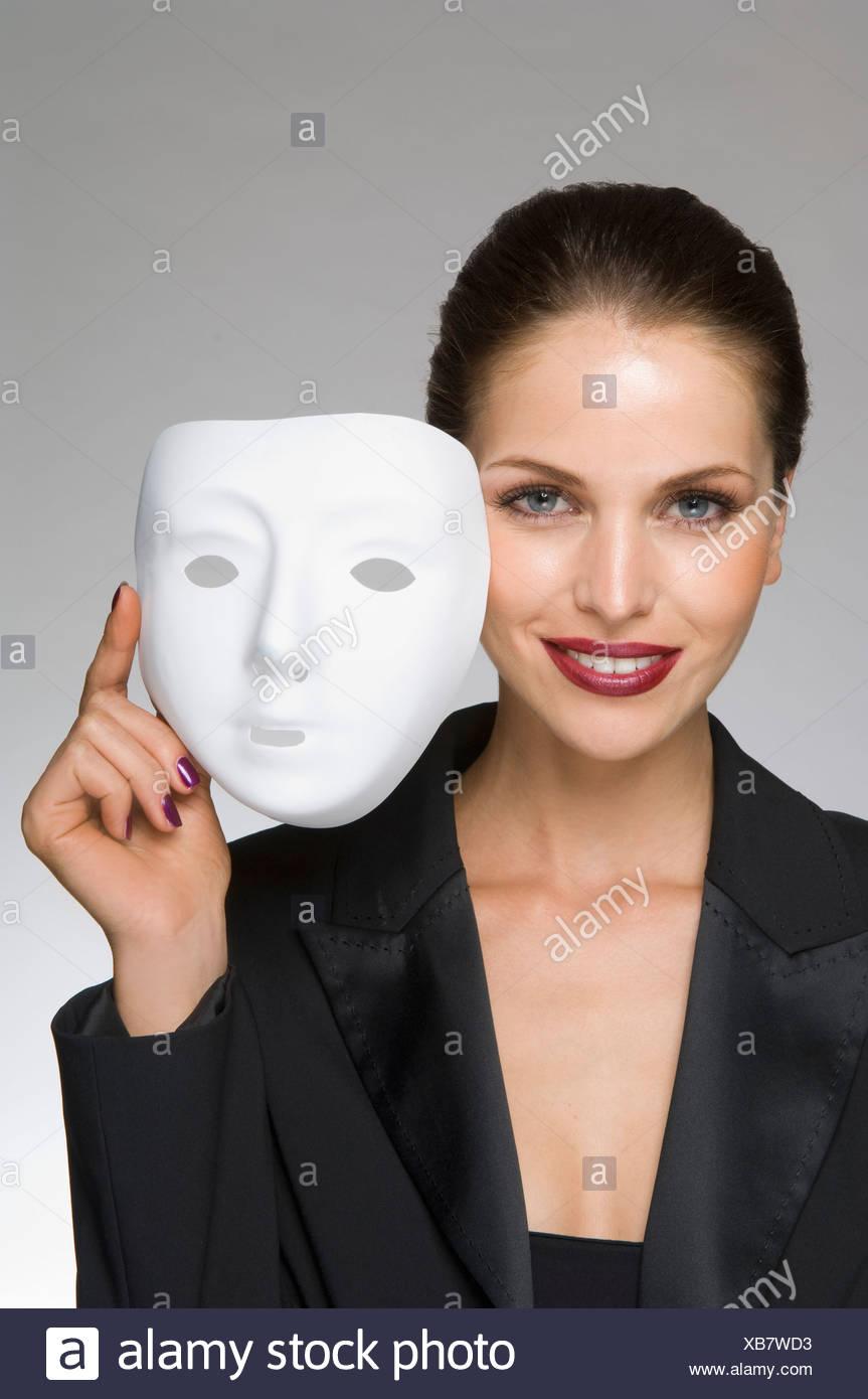 Come femmina business donna con maschera Immagini Stock