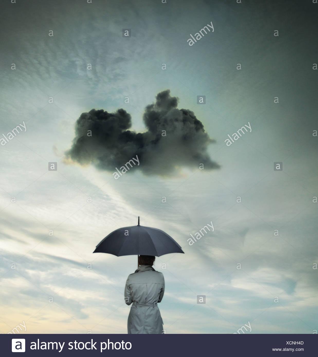 Business donna con un ombrello Immagini Stock