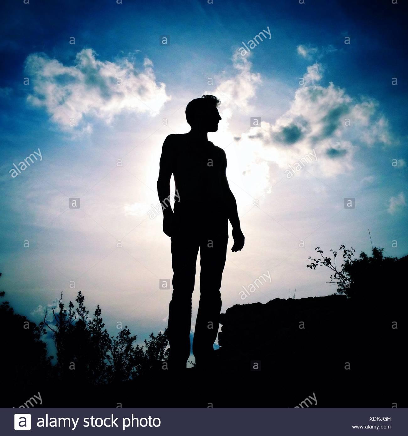 Silhouette di uomo Immagini Stock