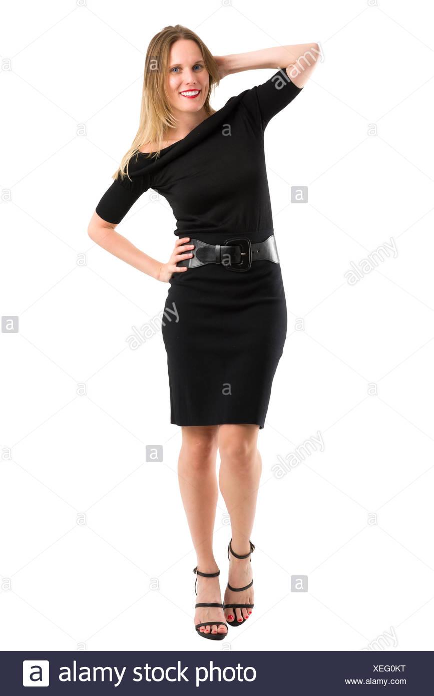 promo code 5a0e3 fe821 Attraente donna bionda in elegante abito nero, isolato su ...