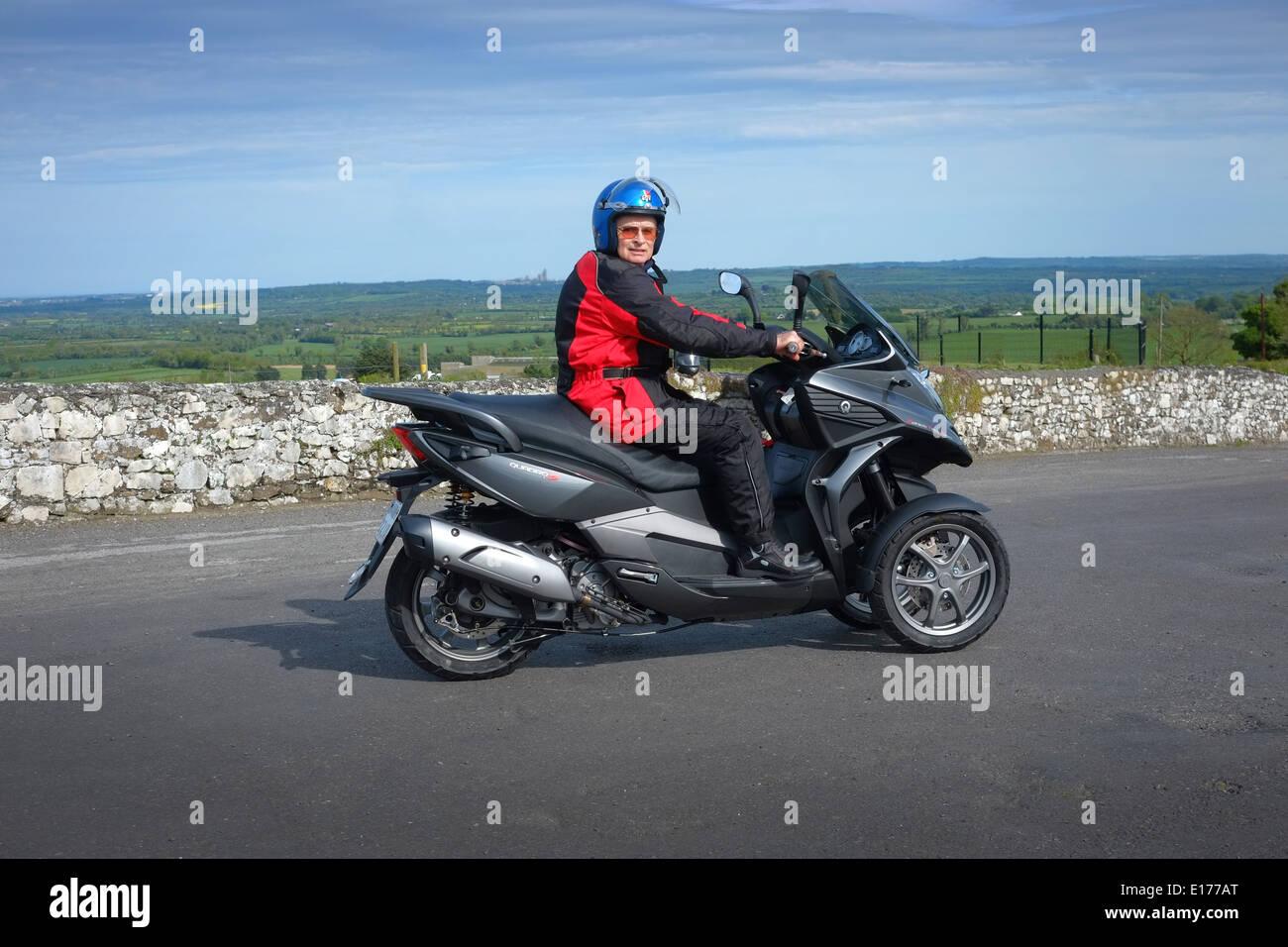 three wheeled Motor scooter, Man on a Quadro 350s tilting three