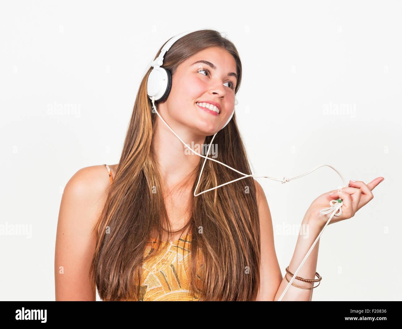 Junge Frau mit Kopfhörern Imagens de Stock