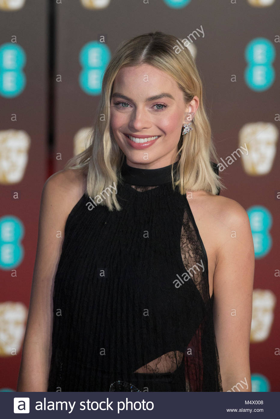 Londres, Reino Unido. 18 de Fevereiro 2018. Margot Robbie na cerimônia de entrega dos prêmios BAFTA são realizadas Foto de Stock