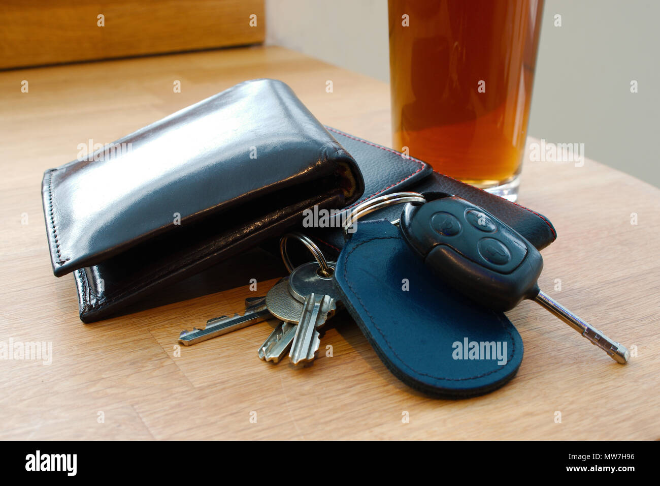Wallet Car Key House Keys And Mobile Phone On A Table Together