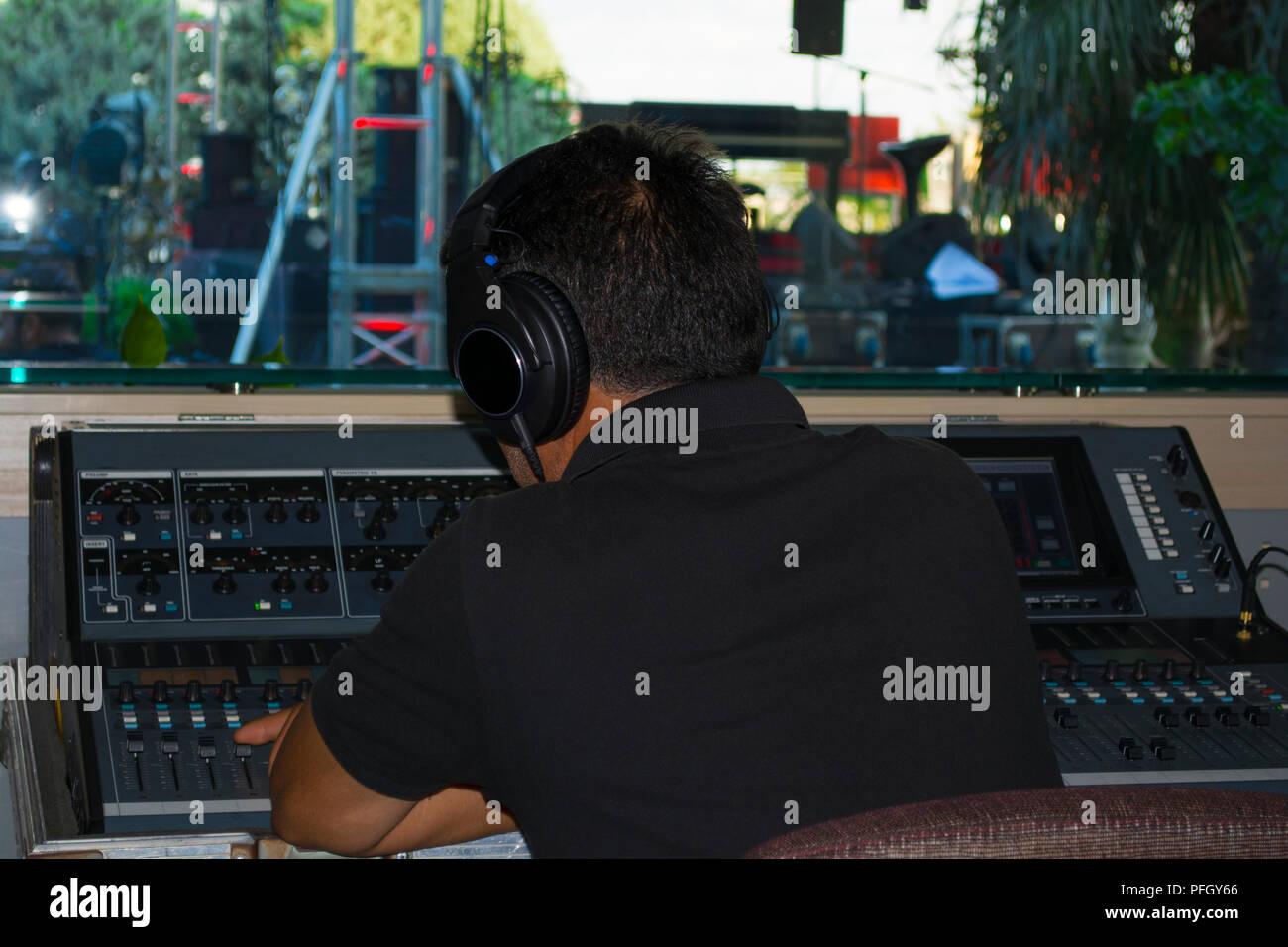 man stage sound mixer at sound engineer hand using audio mix